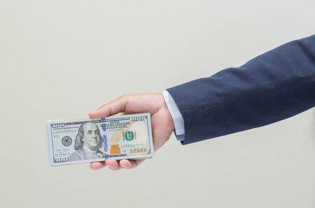usd: Businessman hand grabbing US dollar banknote, USD