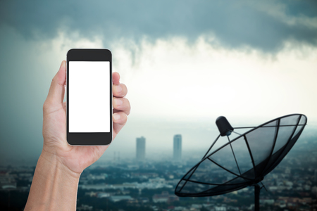 satelite: Hand holding blank screen mobile phone with satelite dish background for  telecommunication technology concept Stock Photo