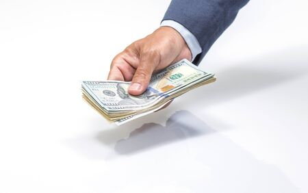 handing over: Businessman hand holding US. dollar banknote Stock Photo
