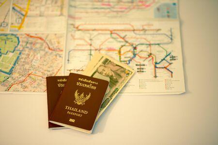blur subway: Passport and Japanese banknote on blur subway map Stock Photo