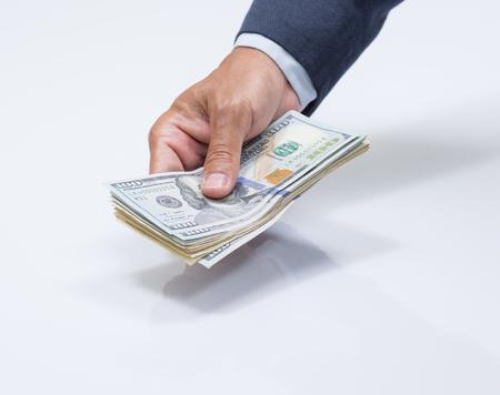 usd: Businessman hand holding US dollar, USD. bills