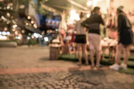 sunday market: Blurred image of night street market, split retro tone color effected Stock Photo
