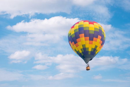 air baloon: Hot air baloon with clouds blue sky background