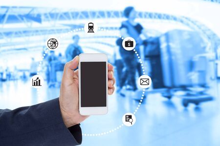 Businessman Hand holding blank screen mobile phone with blurred image of crowd background
