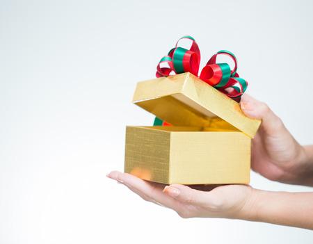 newyear: Woman hand hoding golden gift box