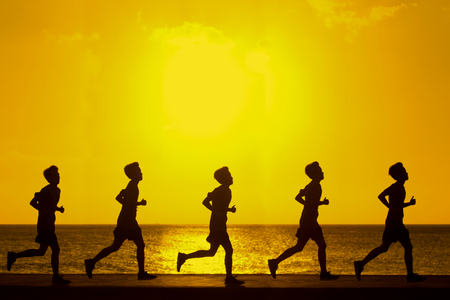 Silhouette of man running at sunset with color filter effected