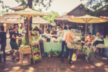 sunday market: Blurred image of people shopping at street market with retro color effected