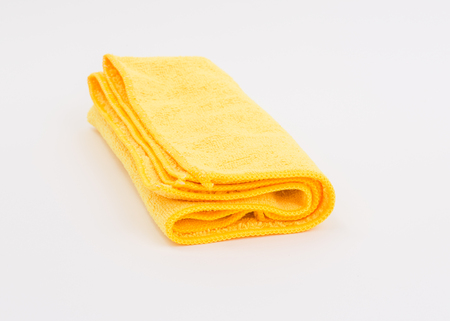 Yellow microfiber cloth on white background