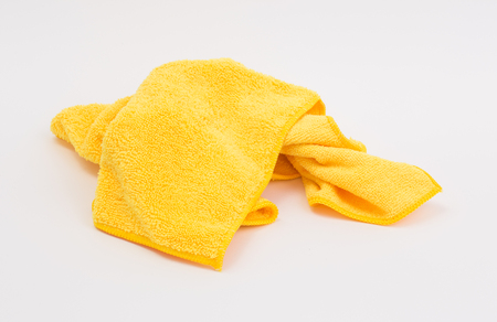 Yellow microfiber cloth on white background