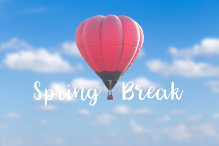 Spring break with red hot air balloon on blur clouds blue sky background Stock Photo