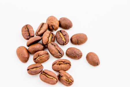 Roasted coffee beans on wood texture background.
