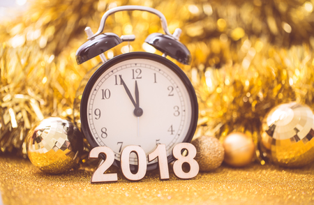 Vintage clock at midnight to happy new year 2018