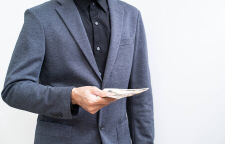 Businessman with ten thousand yen banknote on white background 版權商用圖片