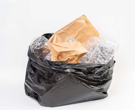 Trash bag with recycle garbage on white background Stock Photo