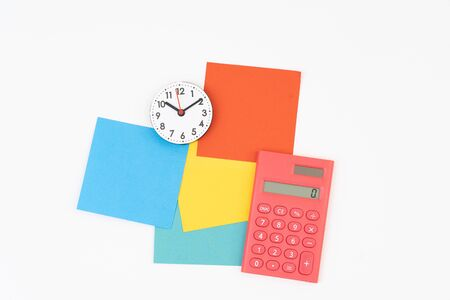 Blank colorful sticky notes with calculator and clock