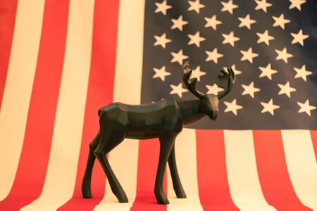 Black raindeer statue with American flag