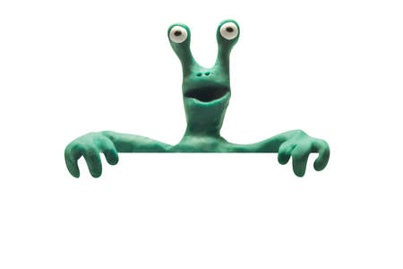 clay alien from behind blank banner isolated with clipping path