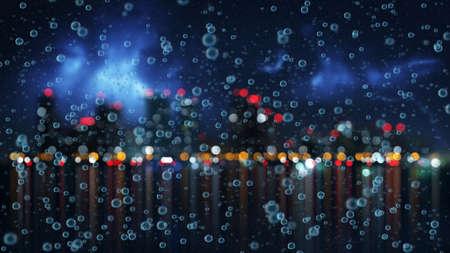 gotas de agua: la lluvia y la noche de la ciudad borrosa en el fondo