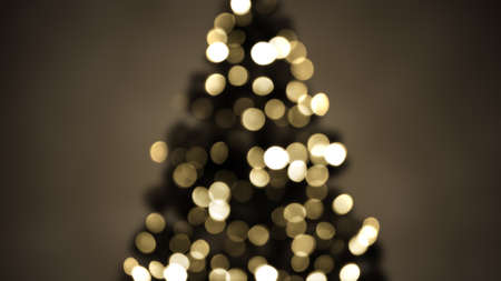 new year of trees: blurred christmas tree lights sepia. abstract festive background