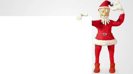 blank board: clay santa claus with white blank board Stock Photo