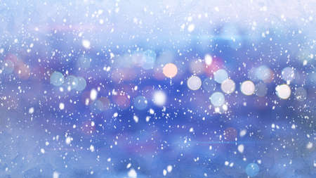 wintry: snowfall and defocused lights evening wintry city