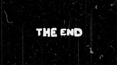 The end white text on black with film noise Stok Fotoğraf