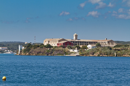 menorca: A centinel tower of La Mola Fortress in front of the bay of Es Castell, Menorca, Spain