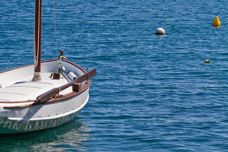 A traditional sail boat  in the bay of Es Castell, Menorca, Spain