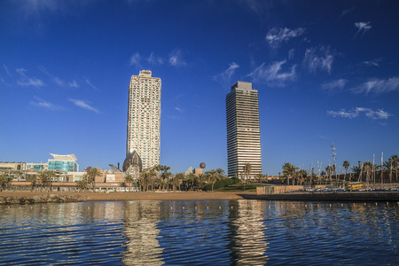 BARCELONA, CATALONIA, SPAIN - December 11, 2016: Barceloneta Beach Port Olimpic, torres Mapfre and Ars, located on front line beach of Barcelona. Around Barceloneta neighborhood. Looking from the sea Editorial