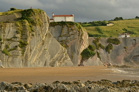 Cliffs of Itzurun beach with Flysch in the foreground.