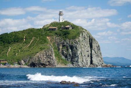 Beacon on a rock on coast of sea of Japan