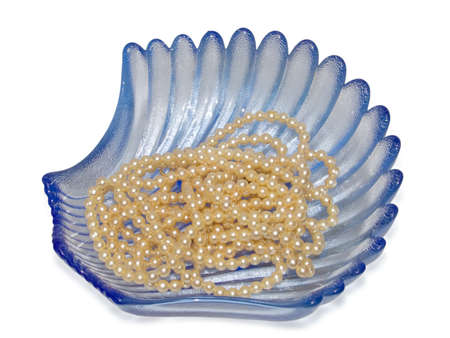 Blue vase and pearls on a white background Stock Photo