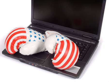 Boxing gloves and the laptop on a white background
