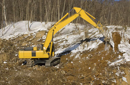excavator on construction of the road in mountain