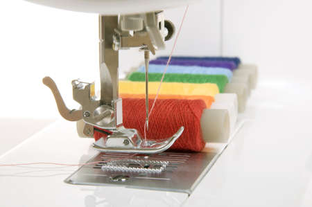 sew: sewing machine and a set of reels with thread