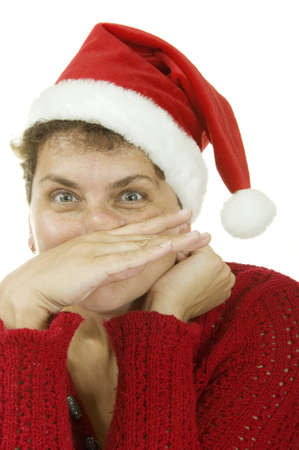 woman in a Santa Claus hat on white background