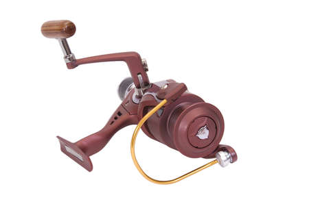 spinning reel: inertia-free spinning reel isolated on a white background Stock Photo