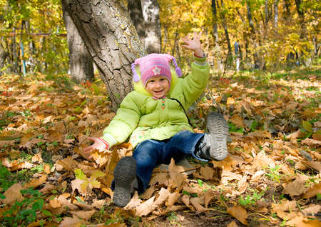 girl sits under tree in autumn park Stock Photo - 13064453