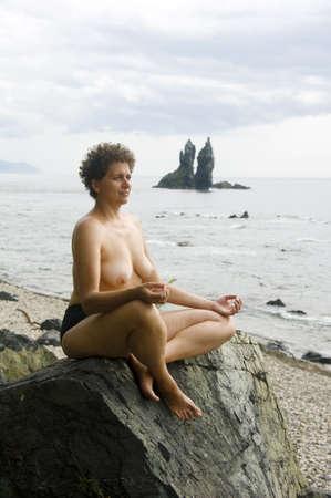 woman meditating on the bank of  Japan Sea photo