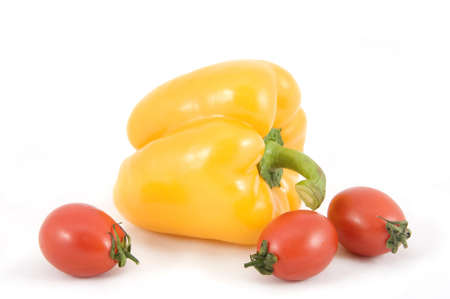Sweet yellow peppers and tomatoes on white background photo