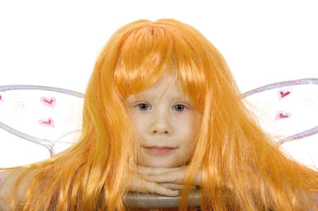 Girl in fancy dress and a wig on a white background Stock Photo