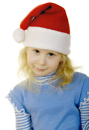 girl in the hat of Santa Claus on a white background photo