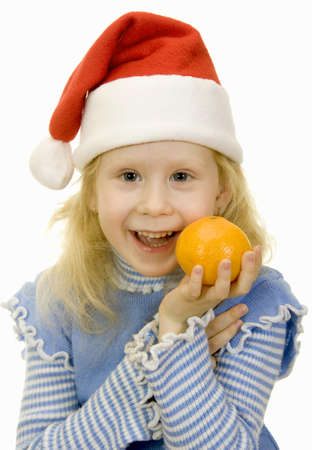 girl in a Santa Claus hat and orange on a white background photo
