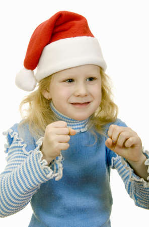 girl in the hat of Santa Claus on a white background