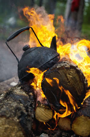 Black tea is on the burning wood