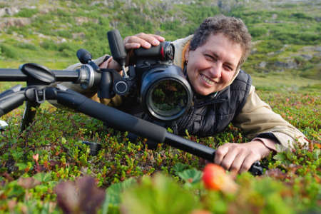 a woman with a camera photographing nature Stock Photo