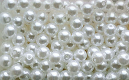 white pearl beads on a white background