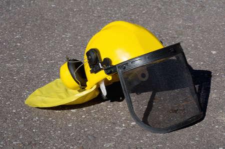 yellow construction helmet on the pavement