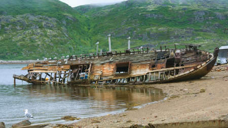 � broken ship on the shore of the Barents Sea