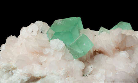 fluorite crystals in calcite isolated on black background